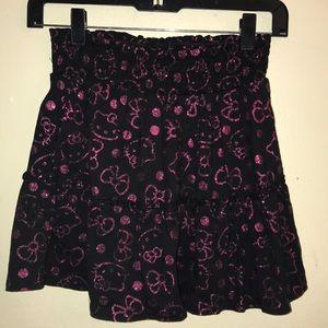 Hello Kitty, black/pink print skirt.size 10/12.